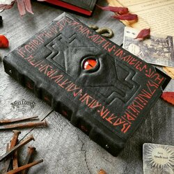 Jigsaw puzzle: Black book with red runes