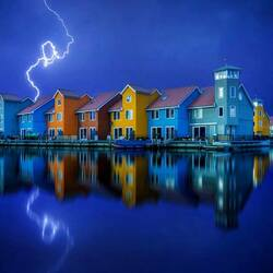 Jigsaw puzzle: Lightning over the village